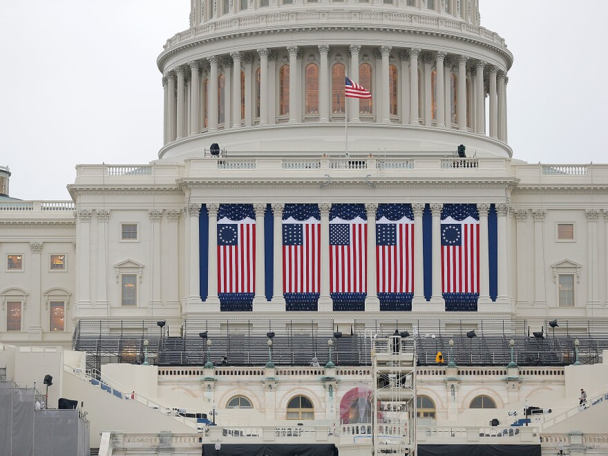 Wednesday's inauguration, coming two weeks to the day after the insurrection on the Capitol, will be unlike any other in living memory, writes NPR's Michel Martin. Above, the Capitol building is seen as workers prepare for the inauguration ceremony for Barack Obama in 2013.