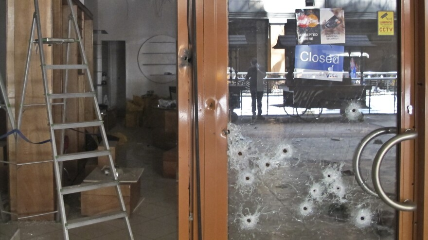 Bullet holes in the glass door of a shop in the Westgate Mall in Nairobi, Kenya.