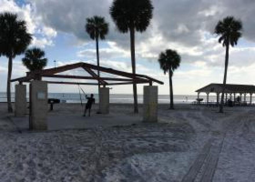 Beachfront amenities at Mac Dill Air Force Base include boat rentals, a bait shop, a tiki bar, and picnic shelters.