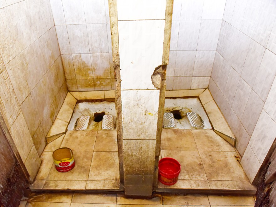 A public squat toilet in Dakar, Senegal.