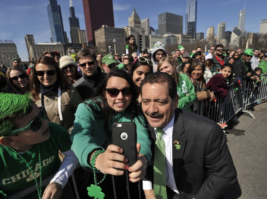 "Samantha Hernandez, 17, poses for a selfie with Chicago mayoral candidate Jesus ""Chuy"" Garcia during the St. Patrick's Day parade in Chicago."