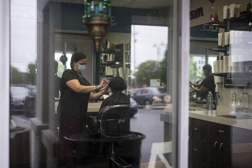 Sarah Young reopened her salon in Creve Coeur this week, but customers at Sola Salon must come in one at a time and follow strict safety rules, including wearing a mask and having their temperature taken. Week of 5/22/20