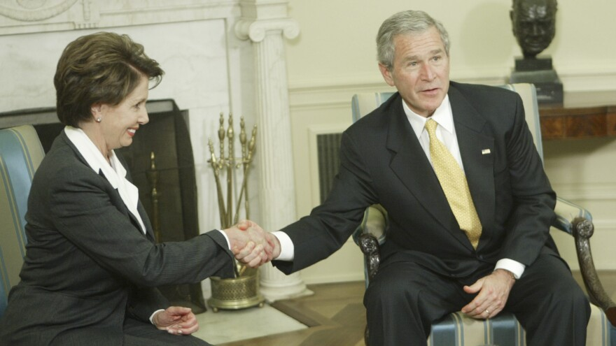 President George W. Bush shakes hands with Nancy Pelosi during their post-election meeting at the White House in November 2006.