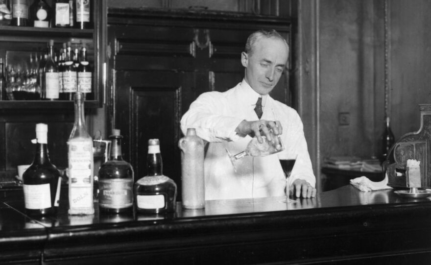 American bartender Harry Craddock mixes a drink at the Savoy Hotel in London in  1926. Craddock is known for helping to popularize the Corpse Reviver, one of the drinks featured in historian Lesley Blume's book about vintage cocktail culture.