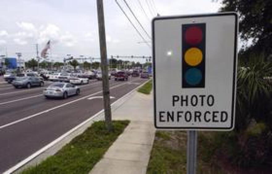 The House is poised to take up a bill that would end the use of red light cameras in Florida. The widow of a man killed by a red-light runner failed to convince the committee they should be allowed.