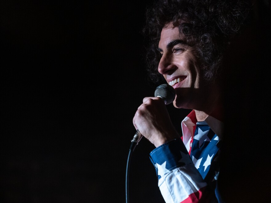 """The more I read about him, I did see some similarity [between us],"" Baron Cohen says of Abbie Hoffman, the real-life activist he plays in <em>The Trial of the Chicago 7. </em>"