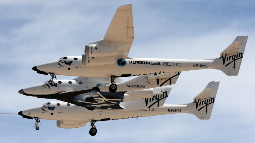 The Virgin Galactic VSS Enterprise spacecraft is seen before its first public landing during the Spaceport America runway dedication ceremony near Las Cruces, N.M., on Oct. 22. Virgin Galactic is one of a handful of private companies that plan to fly paying customers into space.