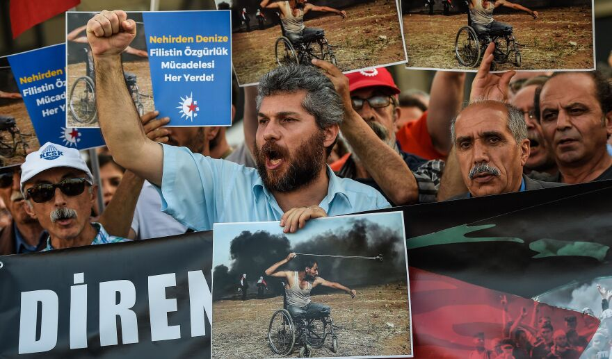 Turkish demonstrators bear signs proclaiming their solidarity with the Palestinians during a rally Tuesday in Istanbul. Turkey's leftist opposition party called the demonstration to protest the killing, the day before, of dozens of Palestinians during clashes with Israeli security forces.