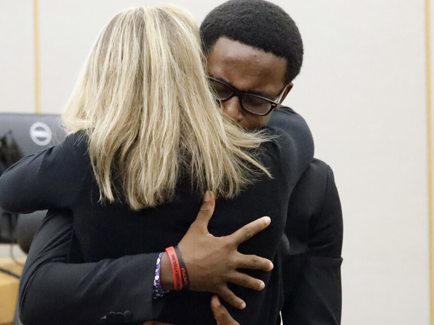Botham Jean's younger brother, Brandt Jean, hugs former Dallas police officer Amber Guyger after delivering his victim-impact statement. Guyger was convicted for Botham Jean's murder on Tuesday and was sentenced to 10 years in prison on Wednesday.