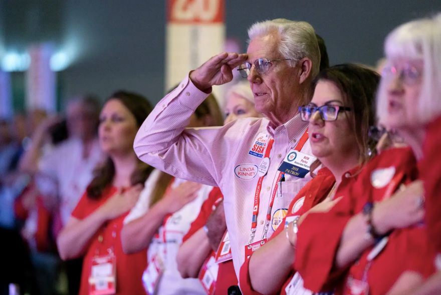 Attendees of theTexas Republican Convention stand for the Pledge of Allegiance in San Antonio in 2018.