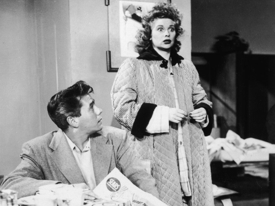 American actor Lucille Ball and Cuban-born actor Desi Arnaz star as a married couple in the television series, <em>I Love Lucy </em>in 1956. The pair were also married in real life.
