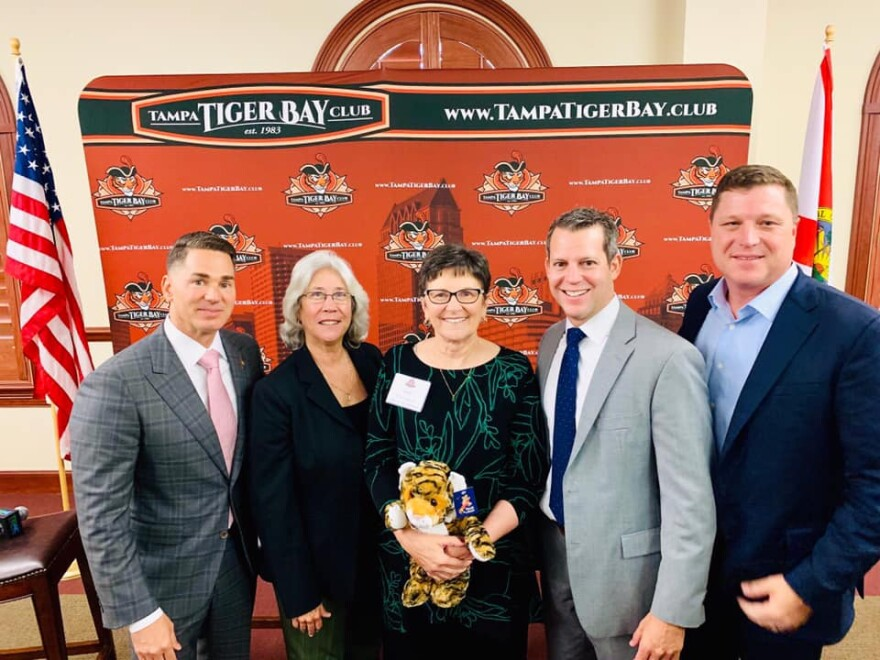 Panelists Hillsborough County Chad Chronister, Julianne Holt, Andrew Warren and Jeff Brandes with Ione Townsend, winner of the Garfield for asking the best question during the discussion of criminal justice reform.