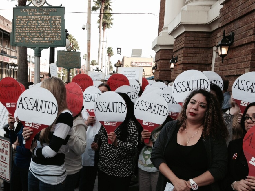 Dozens of nurses rallied on the streets of Tampa's Ybor City Tuesday to push for more workplace safety rules for health care workers.