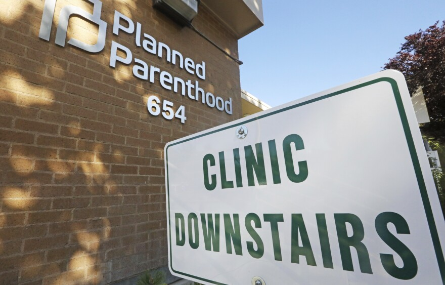 A sign is displayed at Planned Parenthood of Utah Wednesday, Aug. 21, 2019, in Salt Lake City.