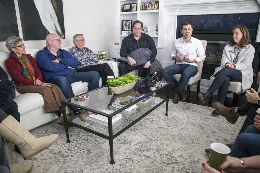 South Bend, Ind., Mayor Pete Buttigieg (second from right) campaigns at a house party in suburban Des Moines on Feb. 9, soon after announcing he was considering a run for the Democratic presidential nomination. Two months later, Buttigieg drew a crowd of nearly 1,600 in Des Moines.