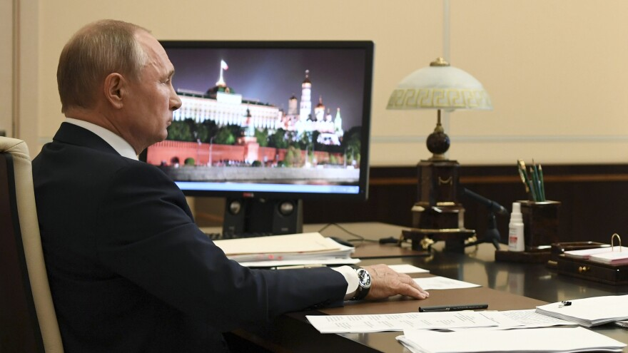 Russian President Vladimir Putin addresses the nation in a televised address on Monday.