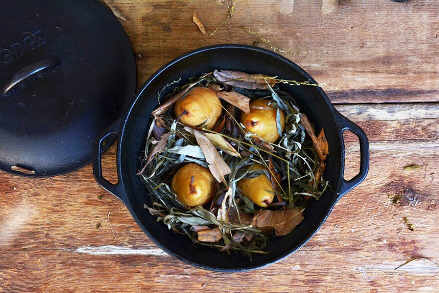 Pears cooked in forest floor: The fruit is cooked in a solar oven on a bed of wild grasses and herbs.