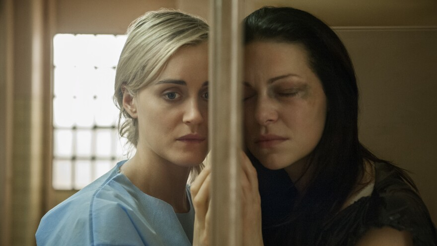 Taylor Schilling, left, with costar Laura Prepon on Netflix's <em>Orange is the New Black</em>.