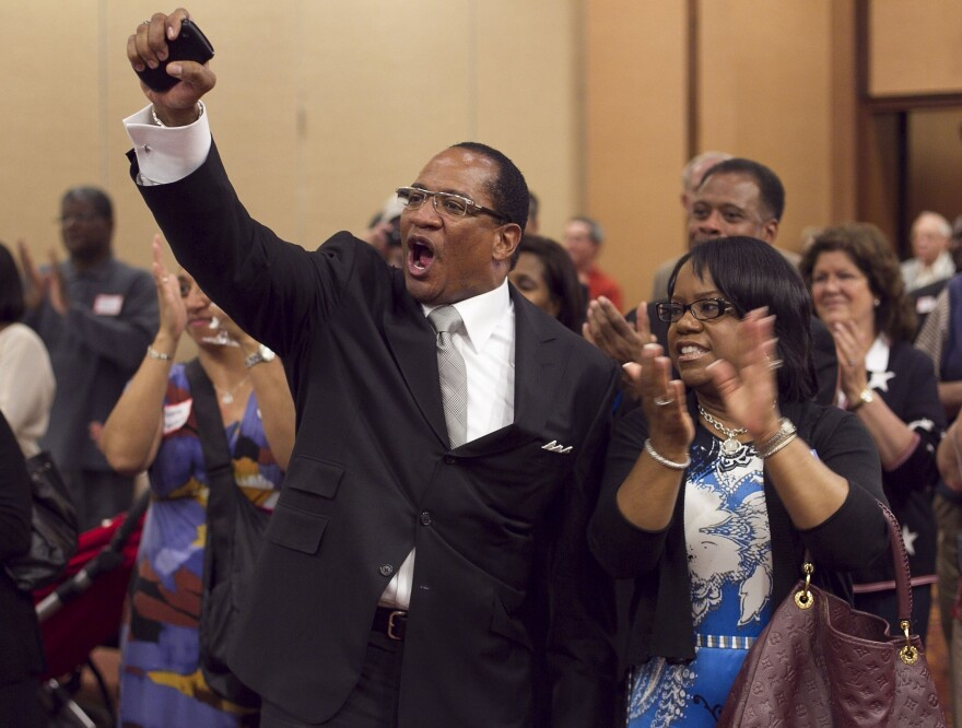Dr. Patrick Wooden, senior pastor of the Upper Room Church of God In Christ in North Carolina, celebrates early returns that show strong support for Amendment One, which bans gay marriage in the state.