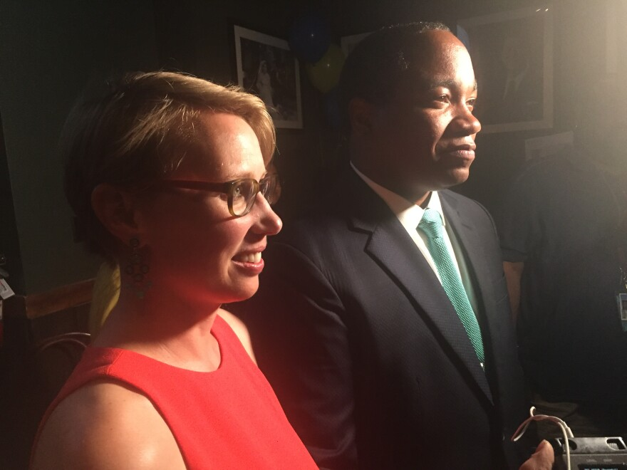 Spencer Merriweather, right, is joined by his wife as he awaits results of the Mecklenburg District Attorney's Race.