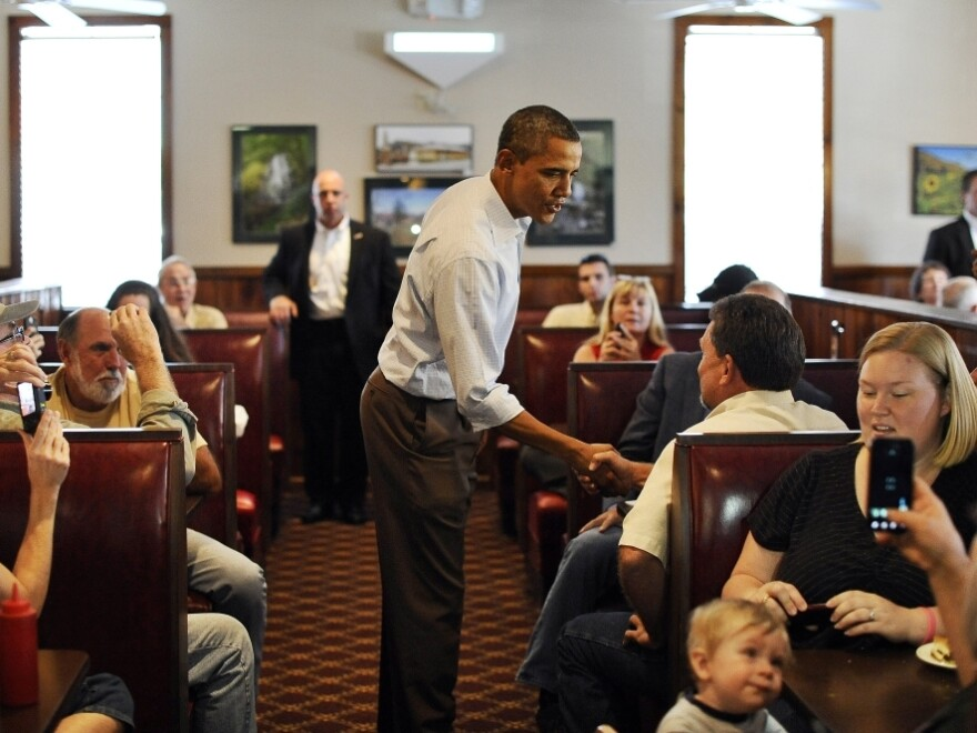 <p>President Barack Obama chats with people after ordering his lunch at Countryside Barbecue in Marion, N.C., Monday, during the first day of his three-day American Jobs Act bus tour to discuss jobs and the economy.</p>