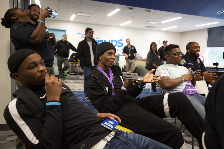 Jawan Coleman (center) asks a question during the Juvenile Justice Jeopardy workshop.
