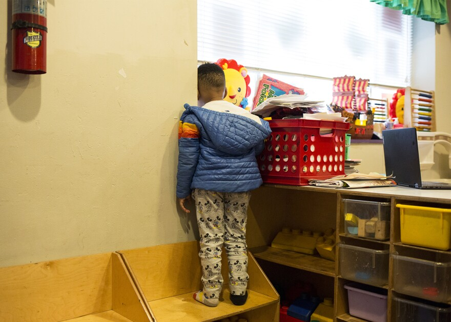 A child looks out the window to watch snow falling at the Little Explorers Learning Center on Jan. 29, 2020. In November 2019, a stray bullet came through the window.