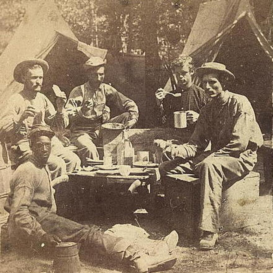 <strong>At Least They Had Real Coffee: </strong>Union soldiers eat and drink in front of tents.