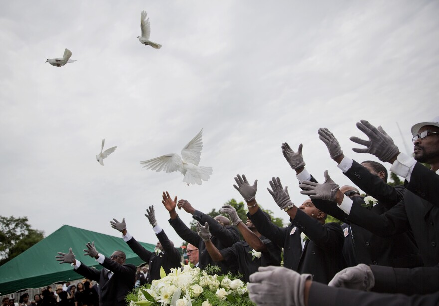 Pallbearers release doves over the coffin of Ethel Lance, one of the nine people killed in the shooting at Emanuel AME Church in Charleston, S.C., during her funeral on June 25, 2015.