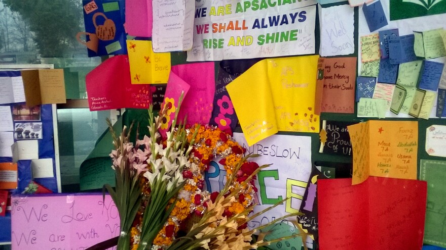 Noticeboards are festooned with pictures, cards and bouquets of flowers at the Army Public School in Peshawar.