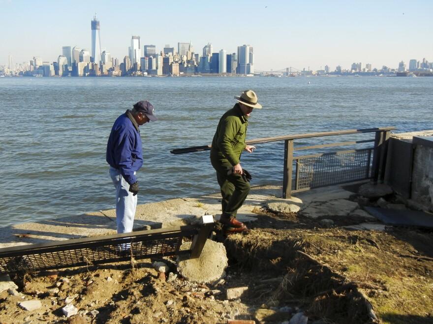 Interior Secretary Ken Salazar (left) and Statue of Liberty National Monument Superintendent David Luchsinger tour flood damage on Liberty Island on Thursday.