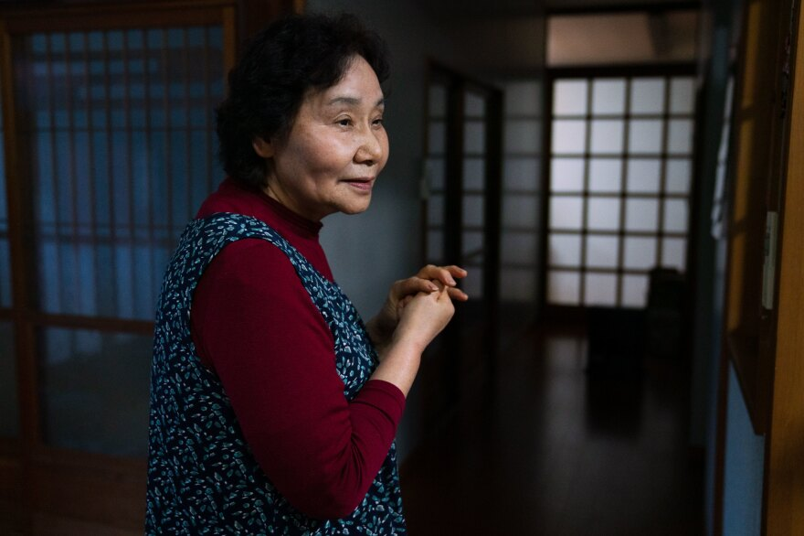 Yuriko Kanno, 75, is amused by the battle between her husband and the monkeys.