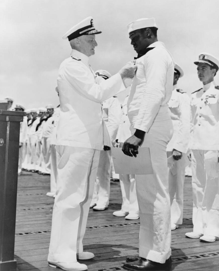 Navy Adm. Chester W. Nimitz pins the Navy Cross on Doris Miller at Pearl Harbor, May 27, 1942.