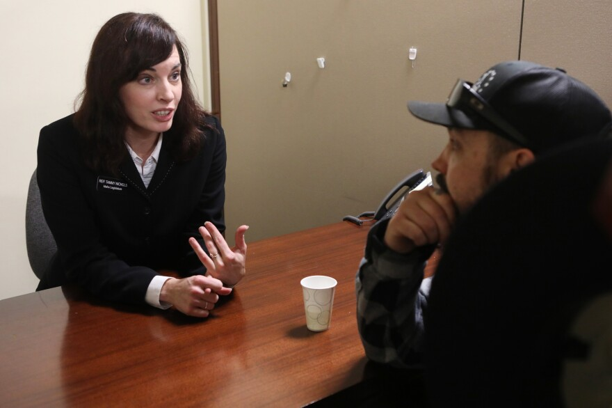 Parker meets with Idaho state Rep. Tammy Nichols, a Republican, at the state capitol in Boise in January.