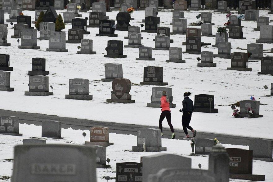 Two joggers run through Grandview Cemetery in Johnstown, Pennsylvania.