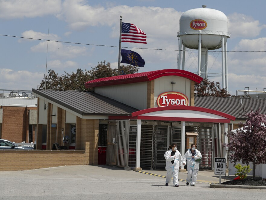 Workers are shown leaving the Tyson Foods pork processing plant in Logansport, Ind., in May. A House subcommittee is investigating the Trump administration's handling of COVID-19 outbreaks at meatpacking plants, focusing on the Occupational Safety and Health Administration as well as major companies Tyson, Smithfield and JBS.