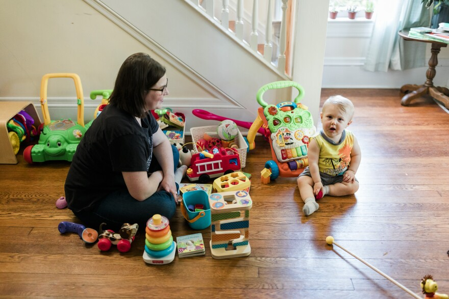 Emma Pepper plays with her son at their home in Charleston. Pepper struggled to breastfeed for six weeks before switching to formula -- a decision she says she wishes she would have made 'much sooner.'