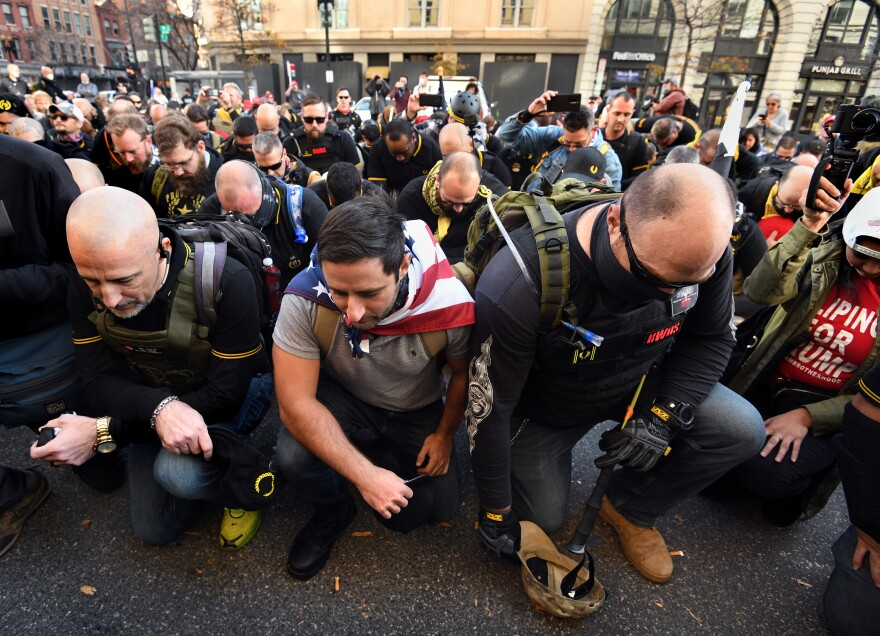 The Proud Boys pray before the march as supporters of President Donald Trump rally at Freedom Plaza and the Supreme Court.