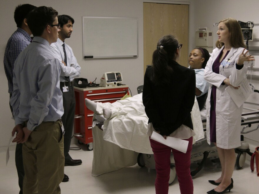 "Chief Medical Resident Dr. Julia Vermylen (right) critiques interns during an ""intern boot camp,"" held at Chicago's Northwestern Memorial Hospital in June."