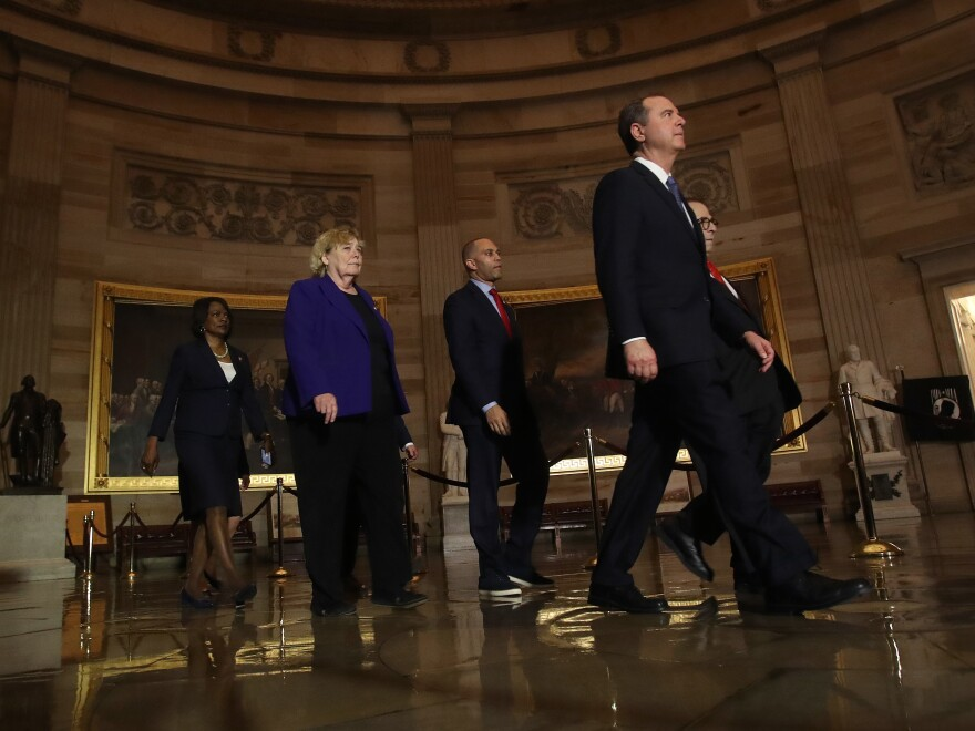 House managers accompany the articles of impeachment against President Trump as they are carried through the rotunda of the U.S. Capitol from the House of Representatives to the Senate on Jan. 15, 2020.