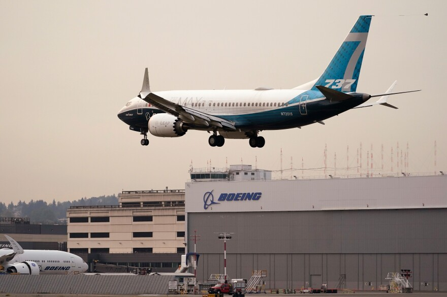 A Boeing 737 MAX jet, piloted by Federal Aviation Administration (FAA) chief Steve Dickson, prepares to land at Boeing Field following a test flight Wednesday, Sept. 30 in Seattle. The MAX was grounded worldwide in early March 2019 after the second of two fatal accidents that together killed 346 people aboard almost-new aircraft.