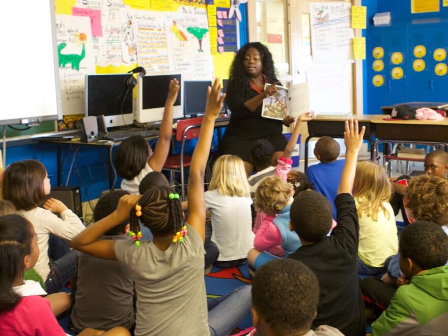 teacher in class with children