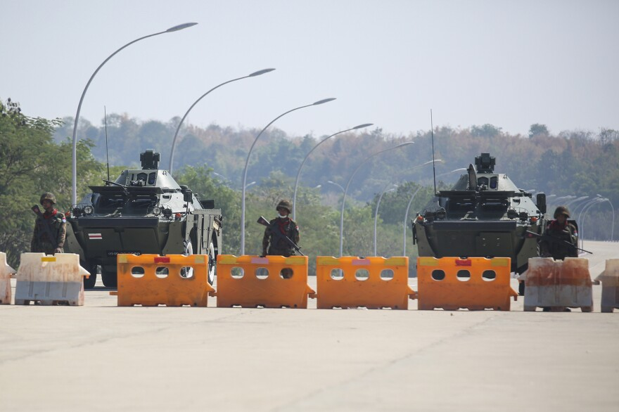 Troops block the road near Parliament in Naypyidaw, capital of Myanmar. Myanmar's military announced Monday that it has seized power and will rule the country for at least one year after detaining its top political leaders.