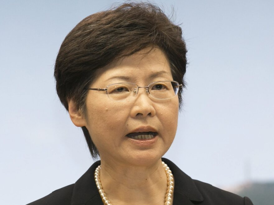 Hong Kong Chief Secretary Carrie Lam speaks during a news conference at a government office Thursday in Hong Kong. She announced that her government was calling off planned talks with student activists.