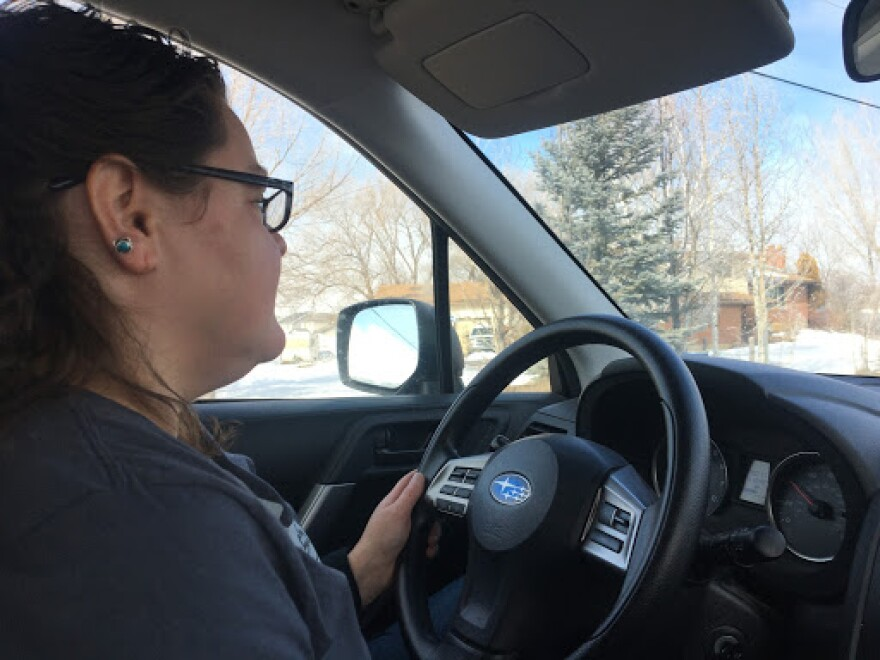Photo of woman driving.