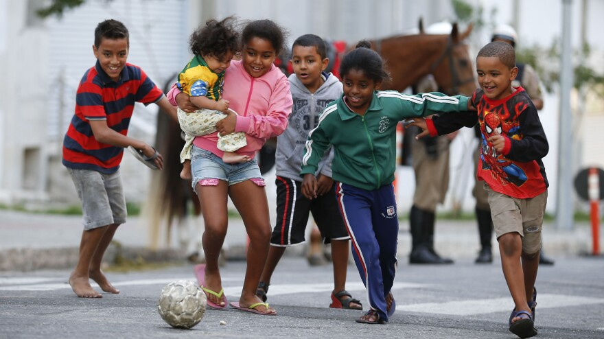 They are feeling it: Children kick around a soccer ball outside the Independencia Stadium in Belo Horizonte, Brazil, on Wednesday.