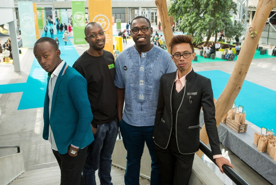 They're guys who stand up for women's rights. Left to right: Patrick Segawa and Steven Twinomugisha of Uganda, Mark Gachagua of Kenya and Bryan Eric Mallari of the Philippines at the Women Deliver conference.