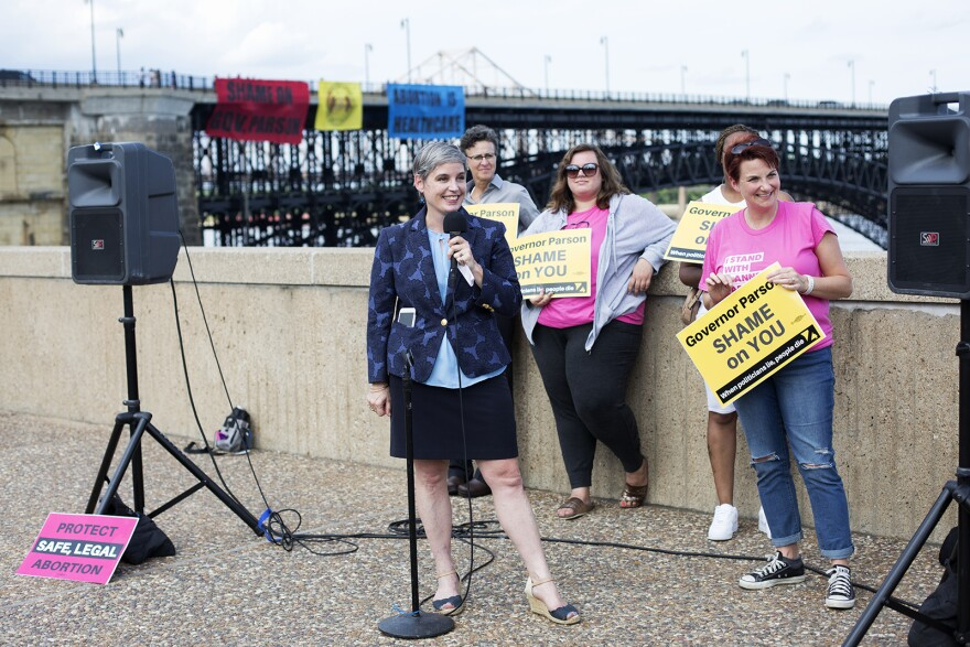 M'Evie Mead, the director of Planned Parenthood Advocates in Missouri, speaks to reporters after a state administrative hearing commissioner extended the St. Louis Planned Parenthood clinic's license until Aug. 1