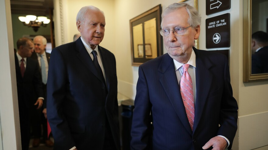 Senate Majority Leader Mitch McConnell, R-Ky., and Republican members of the Senate Judiciary Committee, including Sen. Orrin Hatch, R-Utah, arriving for a news conference on Thursday where they reiterated their plan to bring Kavanaugh's nomination to the Senate floor with a key procedural vote on Friday morning.