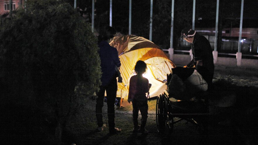 A family sets up a tent for the night in Kathmandu. A second earthquake hit the country just weeks after the first quake struck.
